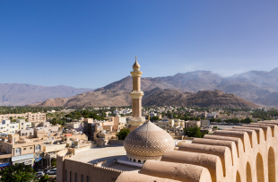 The Grand mosque and minaret in Nizwa - Oman.